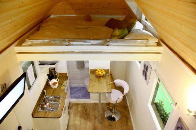 проекти дерев'яних будинків і котеджів з мансардою